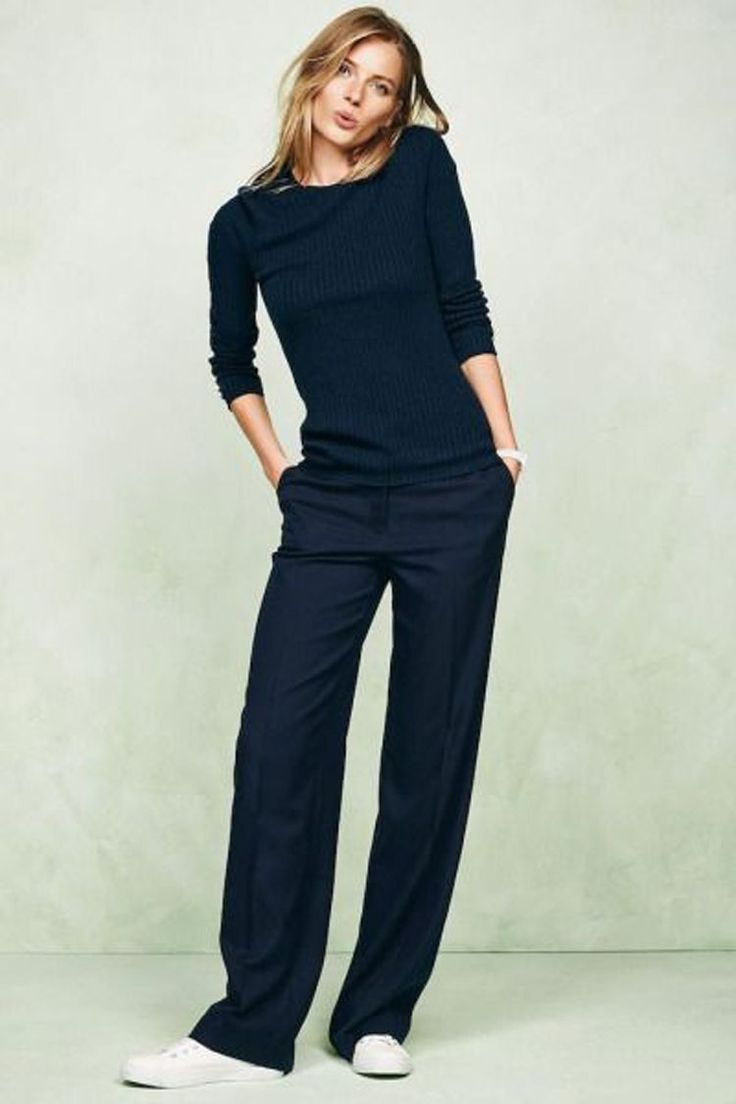 Simple work outfit with white sneakers, navy rib crew neck and trousers.