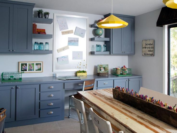 HGTV's Fixer Upper host Joanna Gaines turned this once bland laundry room into a colorful and inspiring craft room. Two bright yellow light fixtures illuminate a large craft table, made from an old pocket door. New blue-gray cabinets provide plenty of storage for the space, and an attractive sheet metal magnet board is a perfect place to display the kids' artwork.