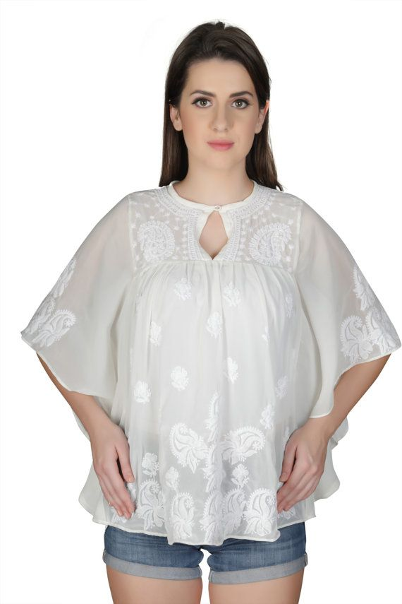 You can never go wrong with this white chikankari poncho crafted using pure and gentle fabric especially for those women who love to flaunt their real self. And while the world is going organic and green in every sense, this beautiful chikankari kurta just lets you be in the flow—is handmade, minimalistic in its design yet high on its appeal and much in lines with today's fashion.     An integral part of Indian culture since 655AD, chinkankari has been strongly rekindled to match the taste…
