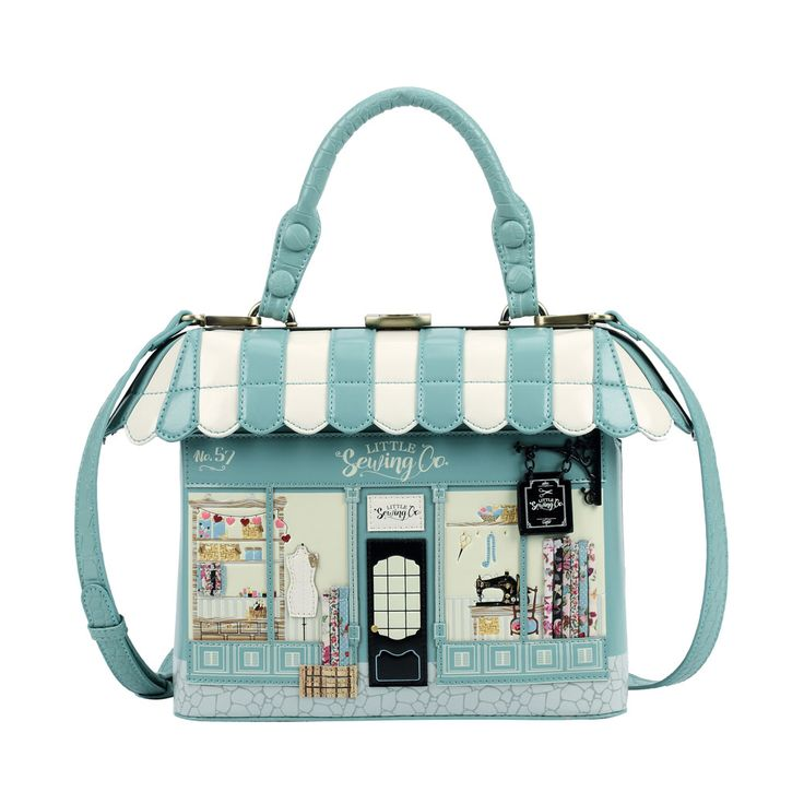 This is the cutest little sewing shop ever! Tailor made to a unique design, the Vendula London sewing shop grab bag is the perfect accessory to give that great vintage look to your spring outfit. D