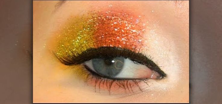 Candy corn eye shadow! How-to steps given at http://makeup.wonderhowto.com/how-to/create-glittery-candy-corn-eye-makeup-look-for-halloween-402247/