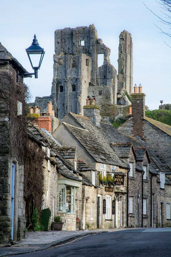 Corfe Castle and the view down West Street, Dorset, England, UK - by Peter Quinn1 -