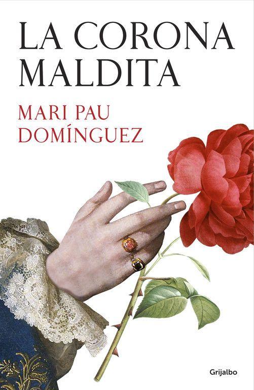 'La corona maldita'. Mari Pau Domínguez vuelve a desvelarnos los secretos más íntimos de los protagonistas de nuestra Historia en esta novela sobre Felipe V, el primer Borbón que reinó en España, y la mujer que estuvo a su lado en el lecho y en el trono.