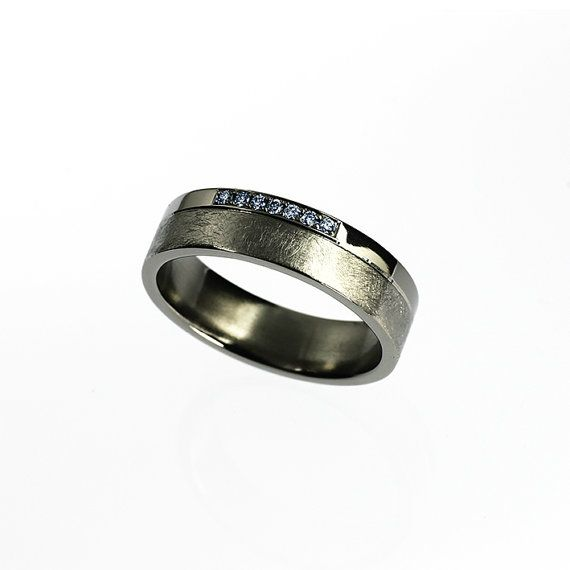Men's titanium wedding ring with blue diamonds by TorkkeliJewellery, $792.00