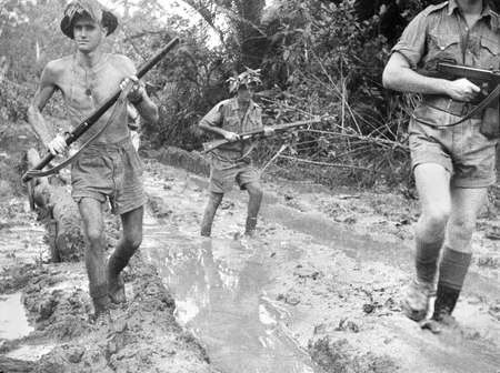 History: These Australian soldiers are at Milne Bay in Papua New Guinea. The New Guinea Campaign (1942-1945) was a battlefield during World War II. At The Battle of Milne Bay, the Americans and Australians were defending against the Japanese.