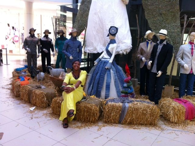 Shweshwe fan posing with the nativity scene in Tyger Valley Centre