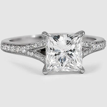 A princess cut diamond shines brilliantly in this diamond embellished split shank setting.