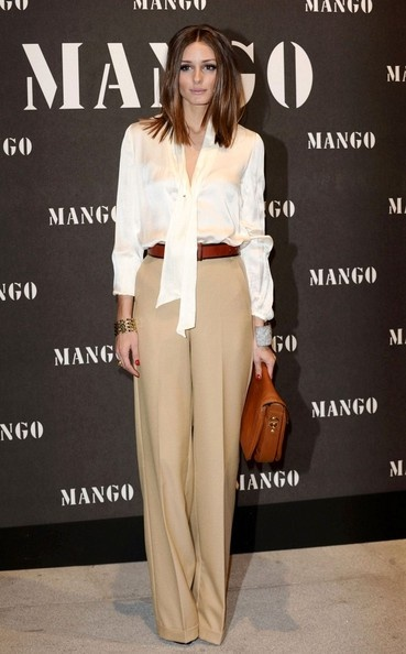 A pressed pair of beige/camel slacks definitely enhances a working woman's wardrobe because it goes with everything.