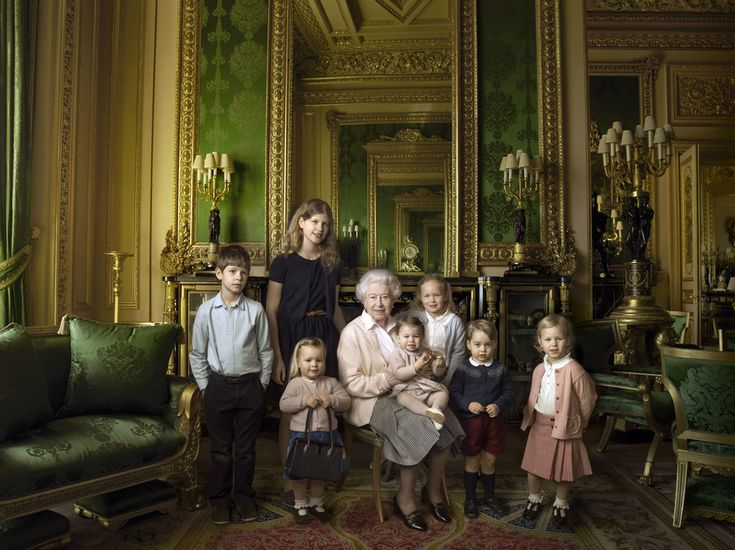 In one of the images the Queen poses alongside her five great-grandchildren and her two youngest grandchildren in the Green Drawing Room, at Windsor Castle.
