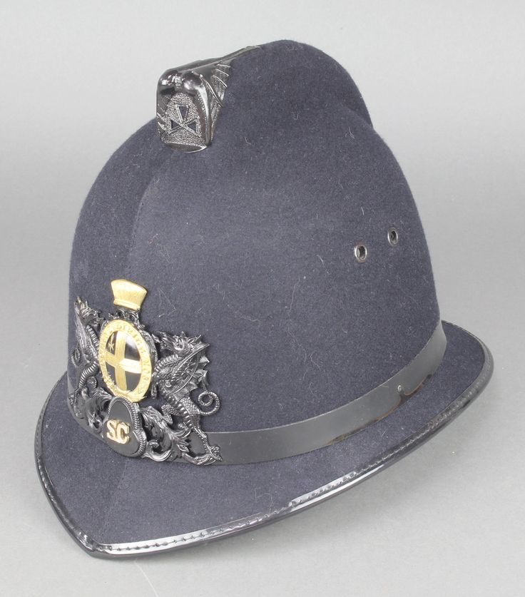 Lot 194, An Elizabeth II issue City of London police Special Constables helmet complete with helmet plate est £75-100