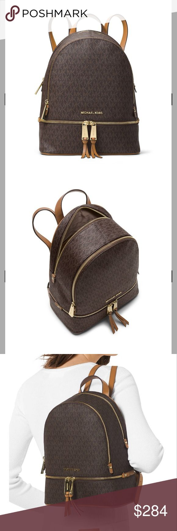 Michael Kors Rhea medium signature backpack Never pay tax or retail here! 1 of these in stock so don't miss out! ladies are carrying backpacks instead of handbags and who said you can't join them? Roomy interior and hands-free handling will allow you to keep all your essentials close at hand. • 9.5-in. W x 12.5-in. H x 5-in. D • Zip closure • Exterior: 2 front zip compartments • Interior: 1 back zip pocket, 1 back slit pocket, 4 front slit pockets • Adjustable shoulder straps • Gold-tone…