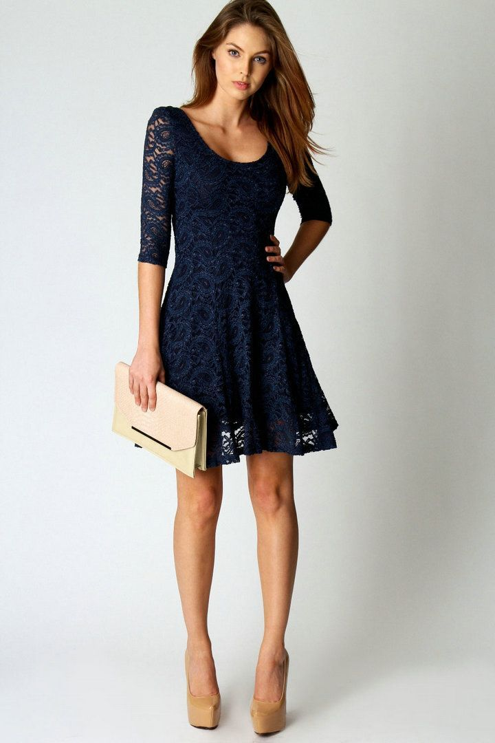 Rock navy lace skater dress for a Sunday lunch with friends. Choose a pair of khaki leather pumps to instantly up the chic factor of any outfit.   Shop this look on Lookastic: https://lookastic.com/women/looks/navy-lace-skater-dress-tan-leather-pumps-beige-leather-clutch/10499   — Navy Lace Skater Dress  — Beige Leather Clutch  — Tan Leather Pumps