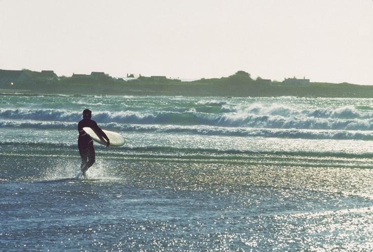 Surfer at Vazon Bay, Guernsey.