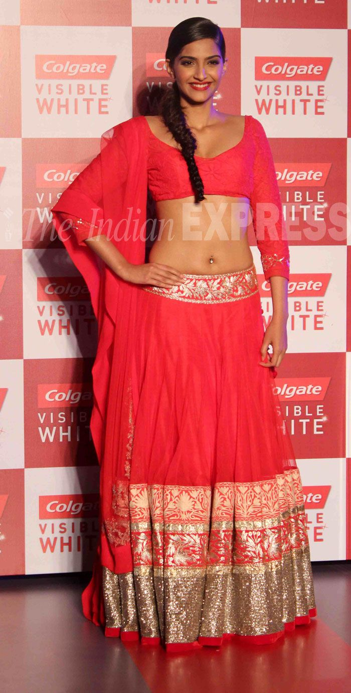 Sonam was ravishing in a red Manish Malhotra lehenga and choli, which revealed her well-toned abs as she walked the ramp at an event in Mumbai.