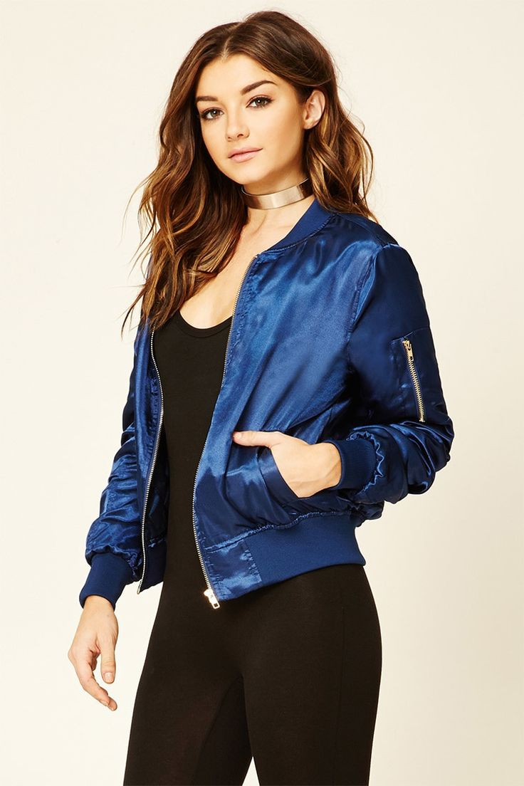 A satin bomber jacket featuring a sheeny design, a quilted interior, slanted…