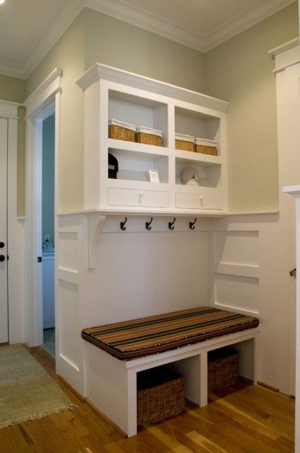 mud room built into a pretty small area. Shelves, hooks, drawers, seat, basket/shoe area, plus add'l storage above shelf unit.