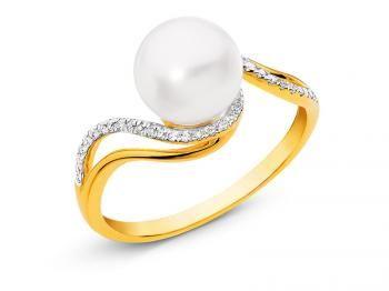 Pierścionek z żółtego złota z diamentami i perłą