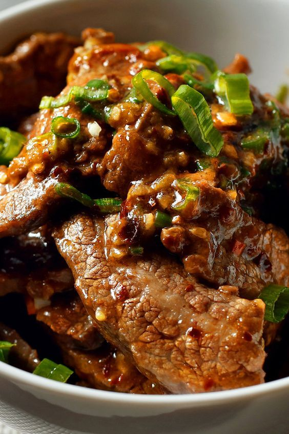 "This fragrant beef stir-fry is an adaptation of one found in Fuschia Dunlop's ""Revolutionary Chinese Cookbook,"" whose subject is the food of Sichuan's less celebrated eastern neighbor, Hunan province. (Photo: Craig Lee for The New York TImes)"
