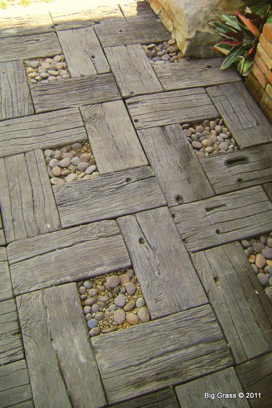 This wonderful decorative rustic garden path uses old boards with stones in