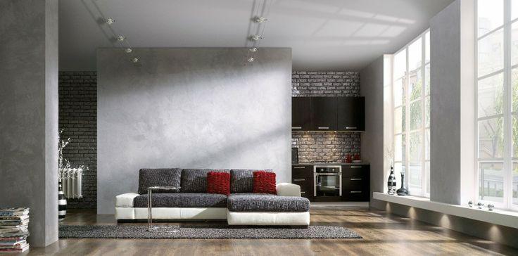 Ściana w pokoju dziennym pokryta tynkiem Beton Magnat Style. Opakowanie 3 kg – 91,14 zł, Magnat.