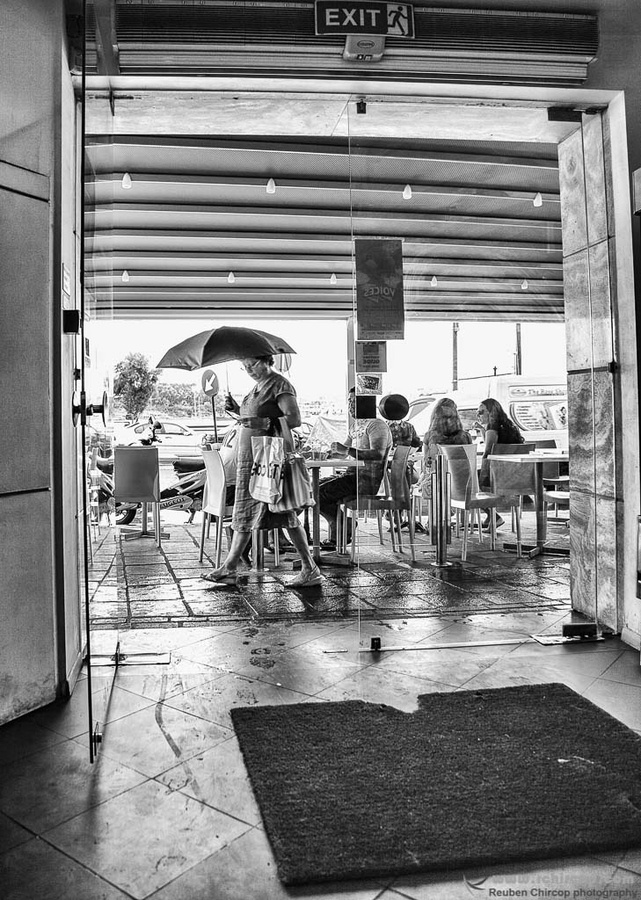 It is not sunny anymore. Resting in this restaurant, watching people run from one shelter to another. It is just water after all.