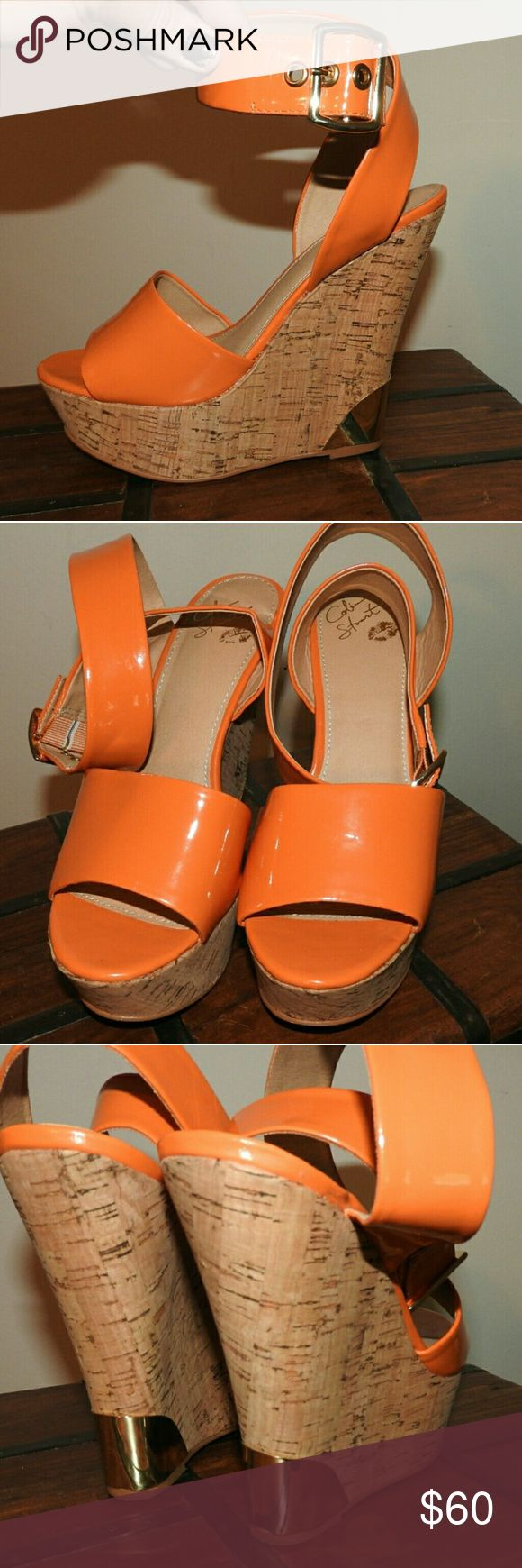 Colin Stuart Wedge High Rise Patent leather orange wedge with gold buckle and heel tap. Cork wrapped heel. Colin Stuart Shoes Wedges