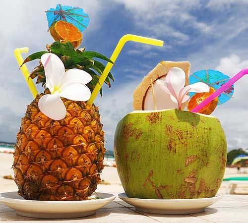 Kinda kitschy but I don't care. I must have drinks garnished with fruit, flowers and/or little umbrellas. I love the coconut and pineapple goblets, too.