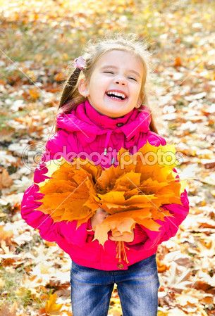Autumn portrait of cute laughing little girl with maple leaves — Stock Image #33275831
