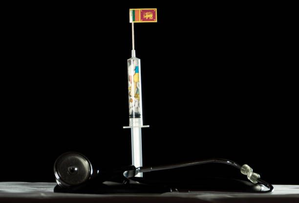 syringe filled with drugs injecting the sri lankan flag