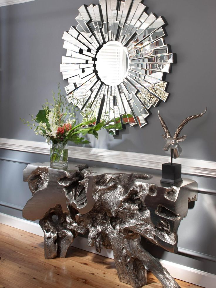 A Funky Side Table And Artistic Mirror Complete The Contemporary Living Rooms Design