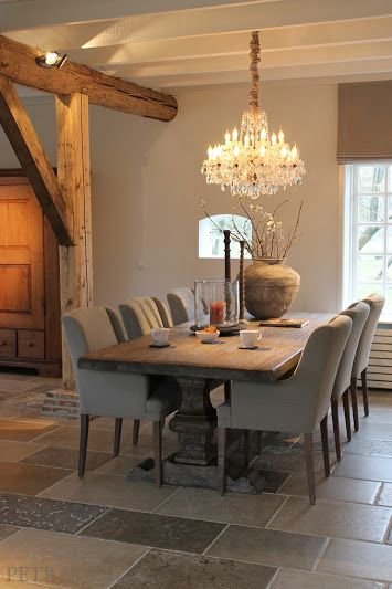 putty upholstered dining chairs and gorgeous taupe walls - Belgian style…