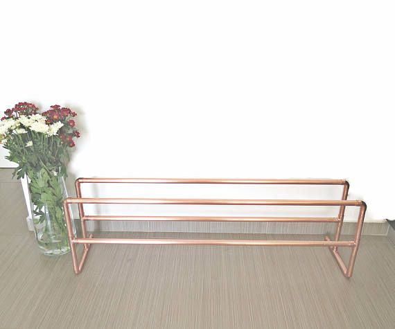 Decorative copper shoe rack made from industrial copper pipes and fittings. Please feel free to email me If you would like more levels for the shoe rack or different dimensions. ~ DIMENSIONS ~ Length: 120cm (47in) Height: 50cm (19.6in) Width: 23cm (9in) Pipe diameter 22mm * Fits