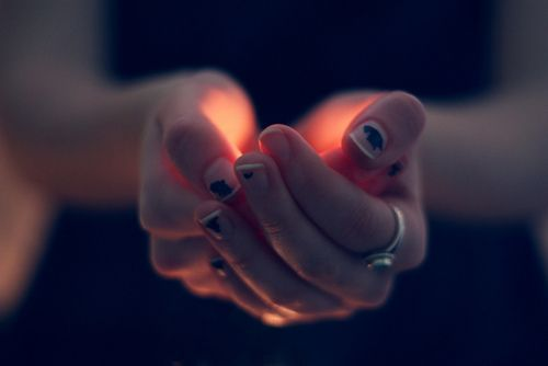 She cupped her palms together and once again felt the soft, familiar tickle of flame.  Somehow it soothed her.