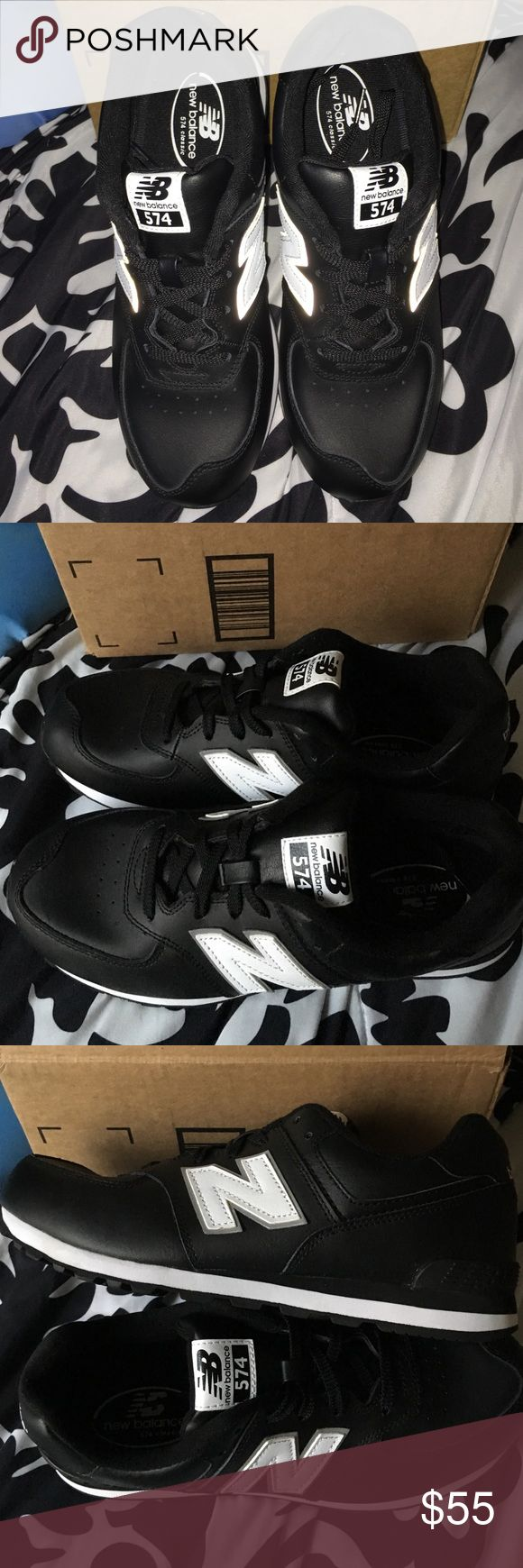 New balance 574 Classics Black with white N. No longer sold in stores. Shiny black material. New. Never used. Shoe box NOT included. Boys size 6. New Balance Shoes Athletic Shoes