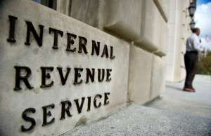 IRS employees exit the US Internal Revenue Service building at the end of the da... - Ann Hermes/The Christian Science Monitor/Getty Images