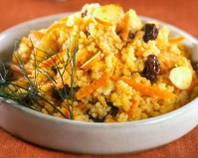Moroccan couscous is enriched with dates, raisins, and almonds and spiced with cinnamon.