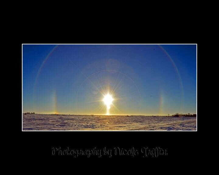 Sun dogs on a cold winter day Saskatchewan.  Photography by Nicole Griffin