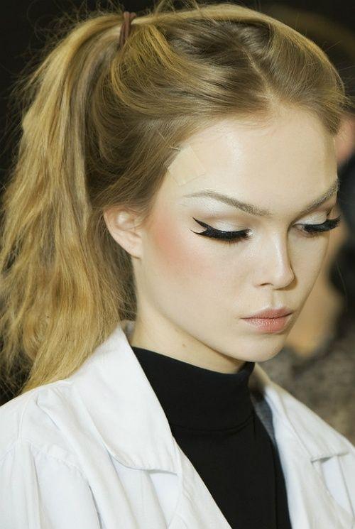 Winged Eyeliner Tutorial Step By Step: Black Winged Eyeliner & Tousled Ponytail; Sandy Blonde