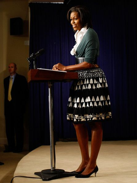 Michelle Obama Kitten Heels     Known for taking chances, Michelle matches a DVF skirt with kitten heels. She displays a great use of color.   Brand: Manolo Blahnik