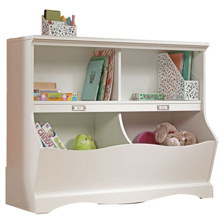 Display board games and picture books in this 4-compartment bookcase for a charming playroom accent, or set it in the sewing room to organize your fabric and...