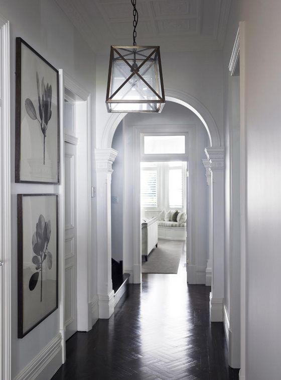 Love this hallway. Dark wood floor, white walls, classic arch, and a great glass and metal light fixture, offset with big black and white art. Classic.   desire to inspire - desiretoinspire.net - Park House: Design Room, Lights Fixtures, Art Prints, Rooms Ideas, Home Design, Lights Fit, Herringbone Floors, Lights Wall, Interiors Decor