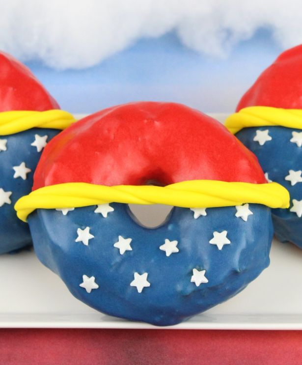 The reasonWonder Woman's home of Themyscira is also known as Paradise Island? Because it's a land filled with donuts. Granted, that's not at all true except in my dreams, but with National Donut Day coming up on June 2and debut of Princess Diana's first starring movie, it's the perfect time to celebrate with a powerful pastry tribute. These Amazonian snacks are easy to fix yourself.They're made from biscuit dough anddipped in a sugary glaze to reflect the memorable colors of Wonde...