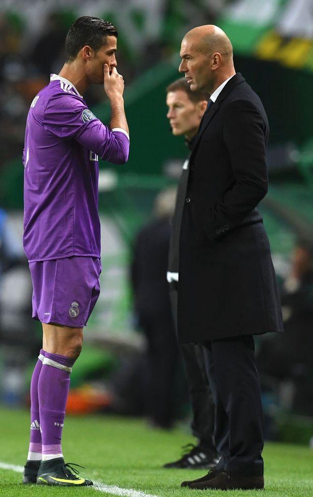Cristiano Ronaldo talks to Zinedine Zidane on the touchline