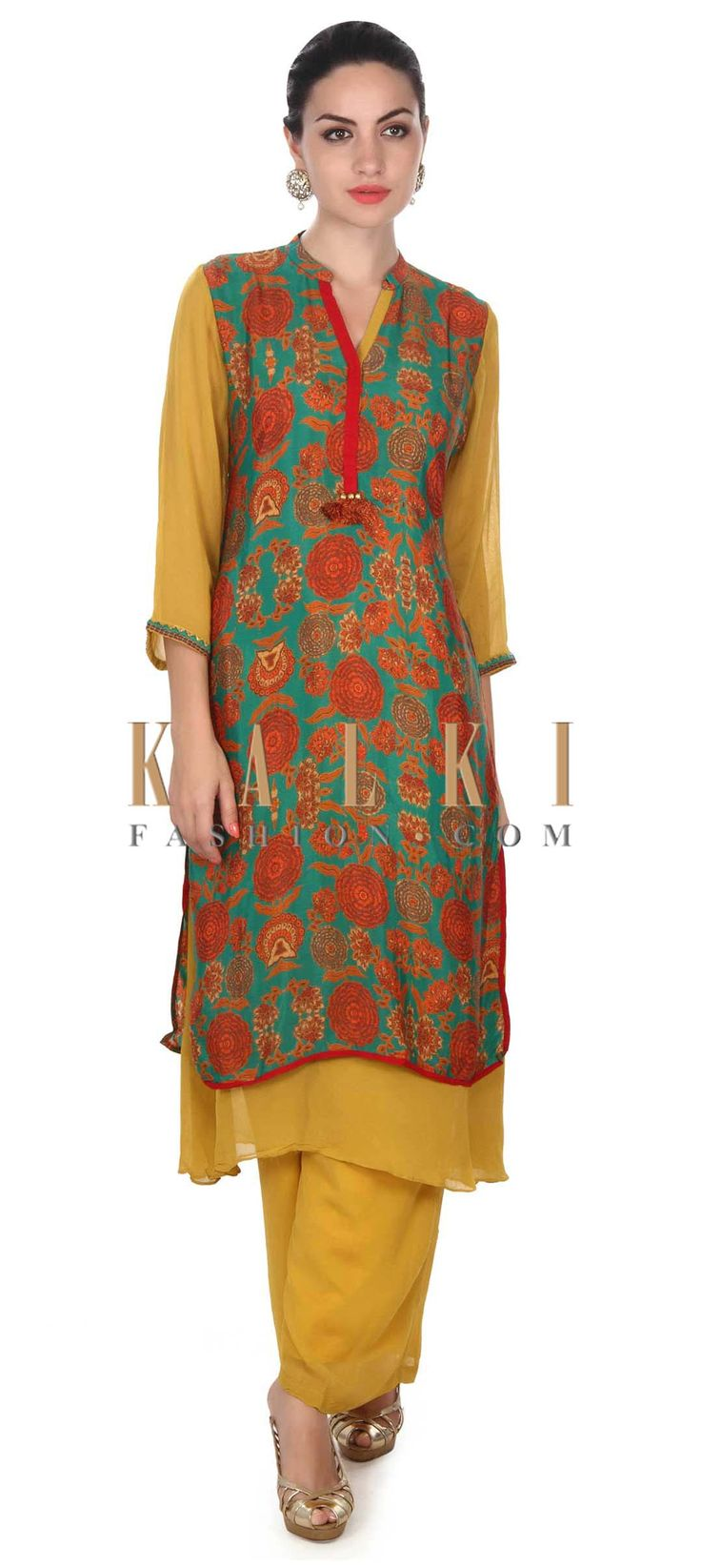 Buy this Green straight suit adorn in floral print only on Kalki