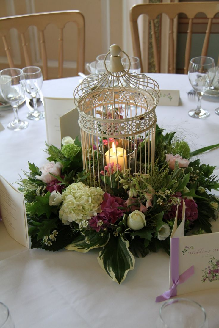 Gold bird cage centerpiece with flower black feather
