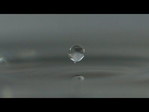 Water Droplet Bouncing on the Surface of Water in Super Slow Motion