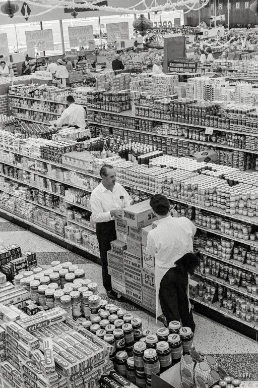 "1963. ""George Jenkins, founder of the Publix supermarket chain, at store in Lakeland, Florida."" 35mm negative by Marvin Newman for the Look magazine assignment ""George Pleasures Them With Groceries."""