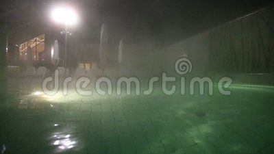 Thermal pool at night -  hot steam is released.