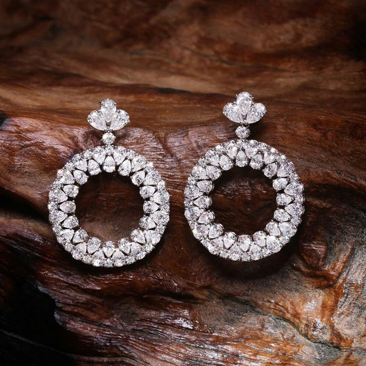 The Classic Collection diamond earrings crafted in…
