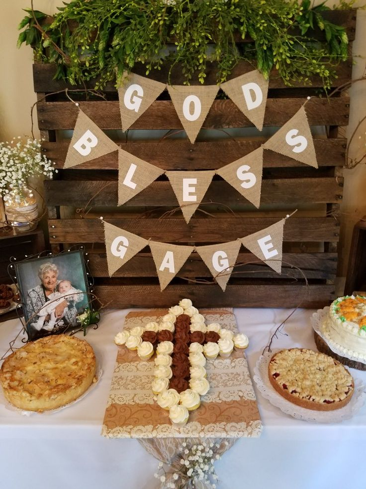 Rustic dessert table with a cupcake cross. Perfect for communion,confirmation baptism  or other religious event
